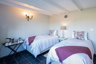 The Daybreak guest bedroom offers two high quality single beds