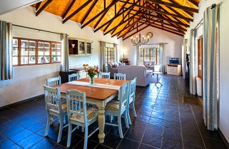 Country guesthouse dining area characterised by a high wooden ceiling